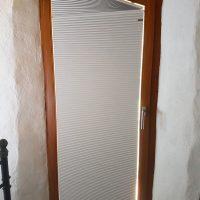 Tende plissé su misura per porta di forma irregolare